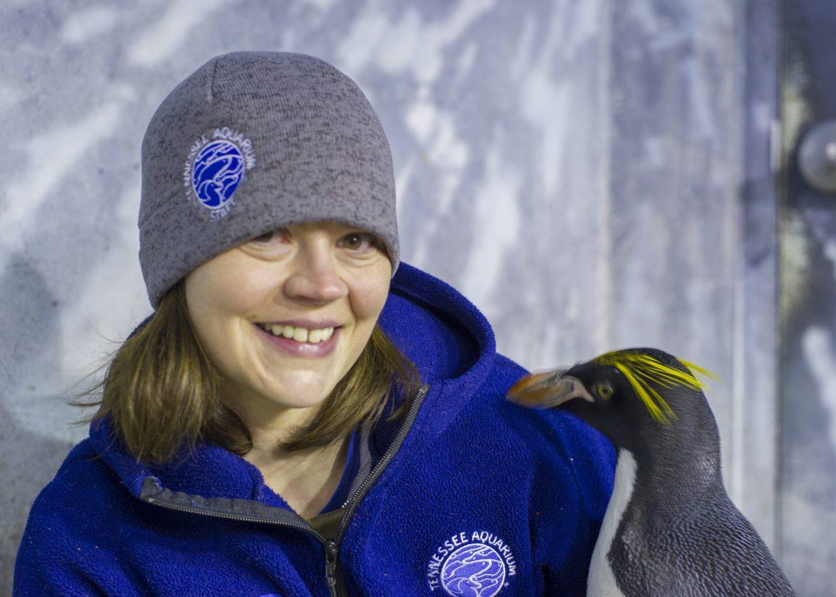 Senior Aviculturist Loribeth Lee next to a penguin