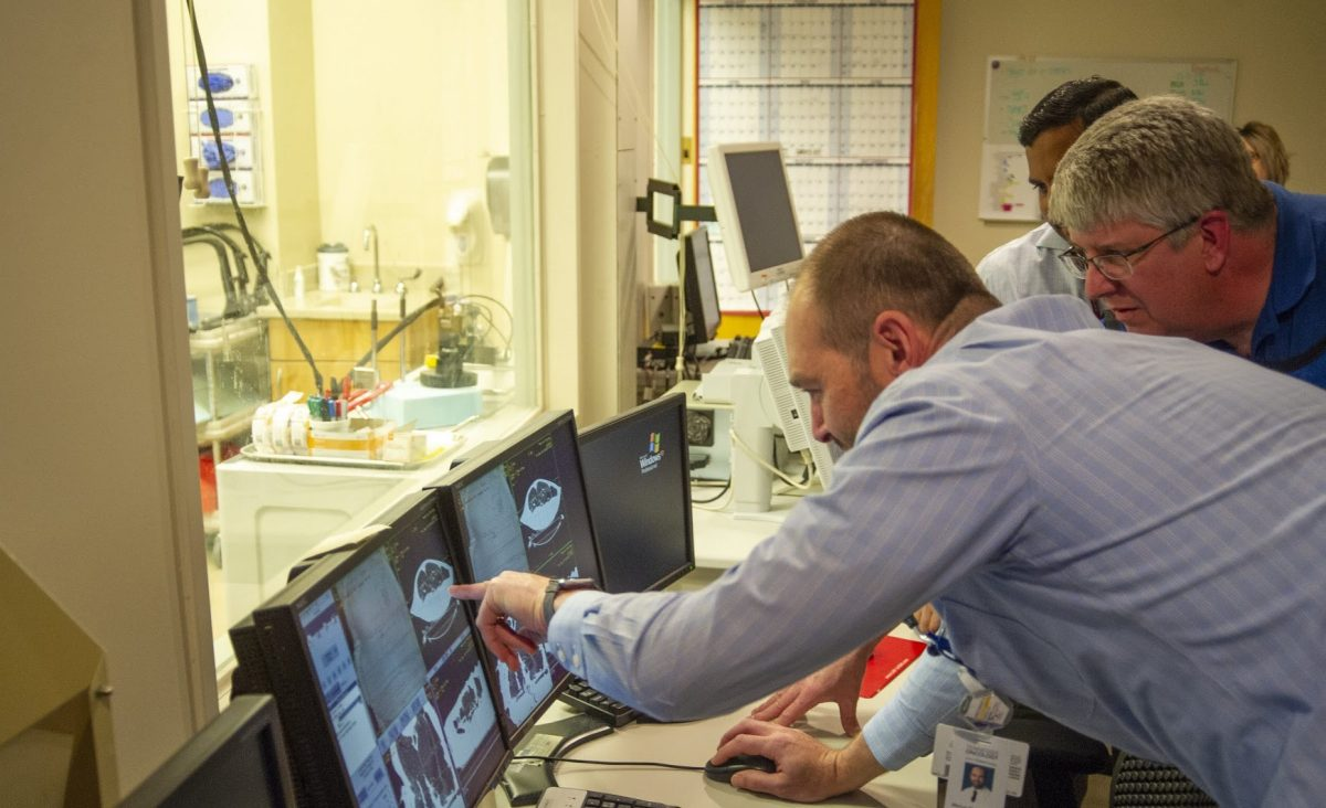 doctor reviewing CT machine screen