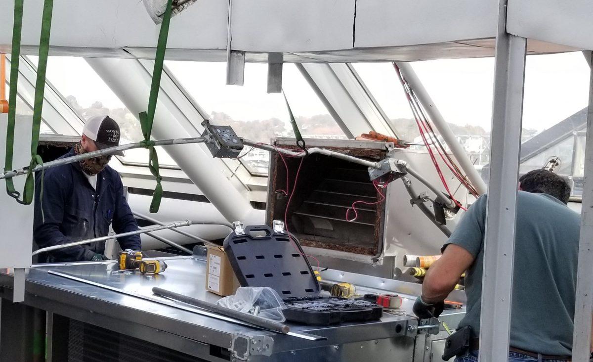 workers installing HVAC upgrade