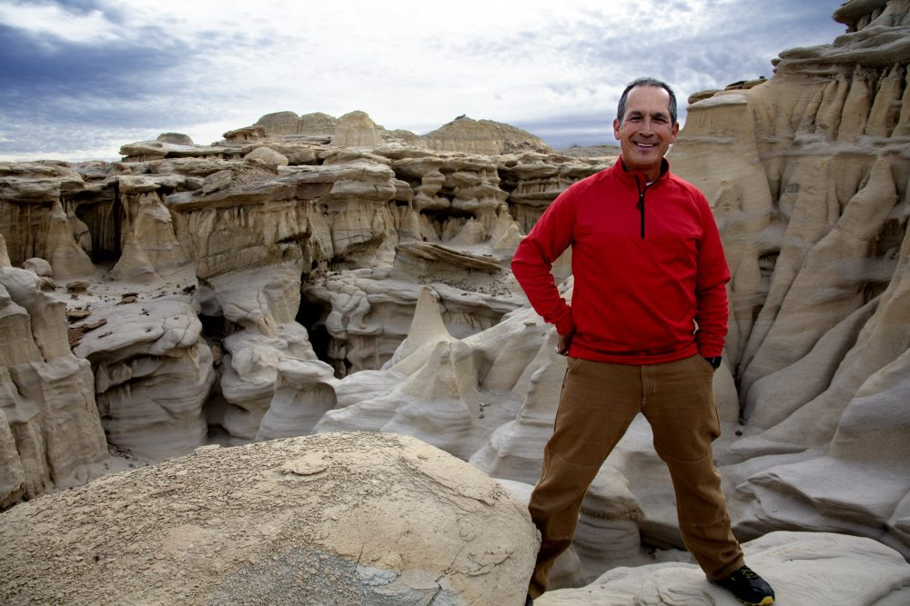 Astronaut John Herrington stands above the other-worldly hoodoo formations in New Mexico's Ah-Shi-Sle-Pah Wilderness