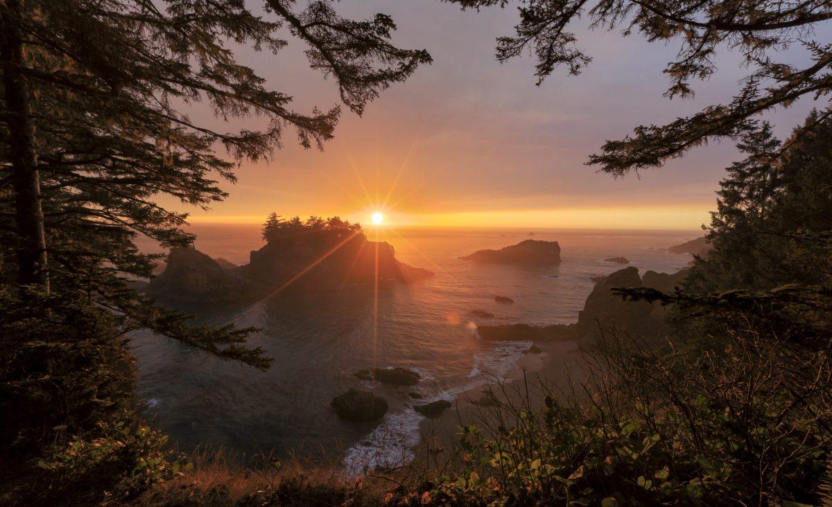Sun sets over the stunning coastline of Secret Beach in the Samuel H. Boardman Scenic Corridor in southern Oregon.