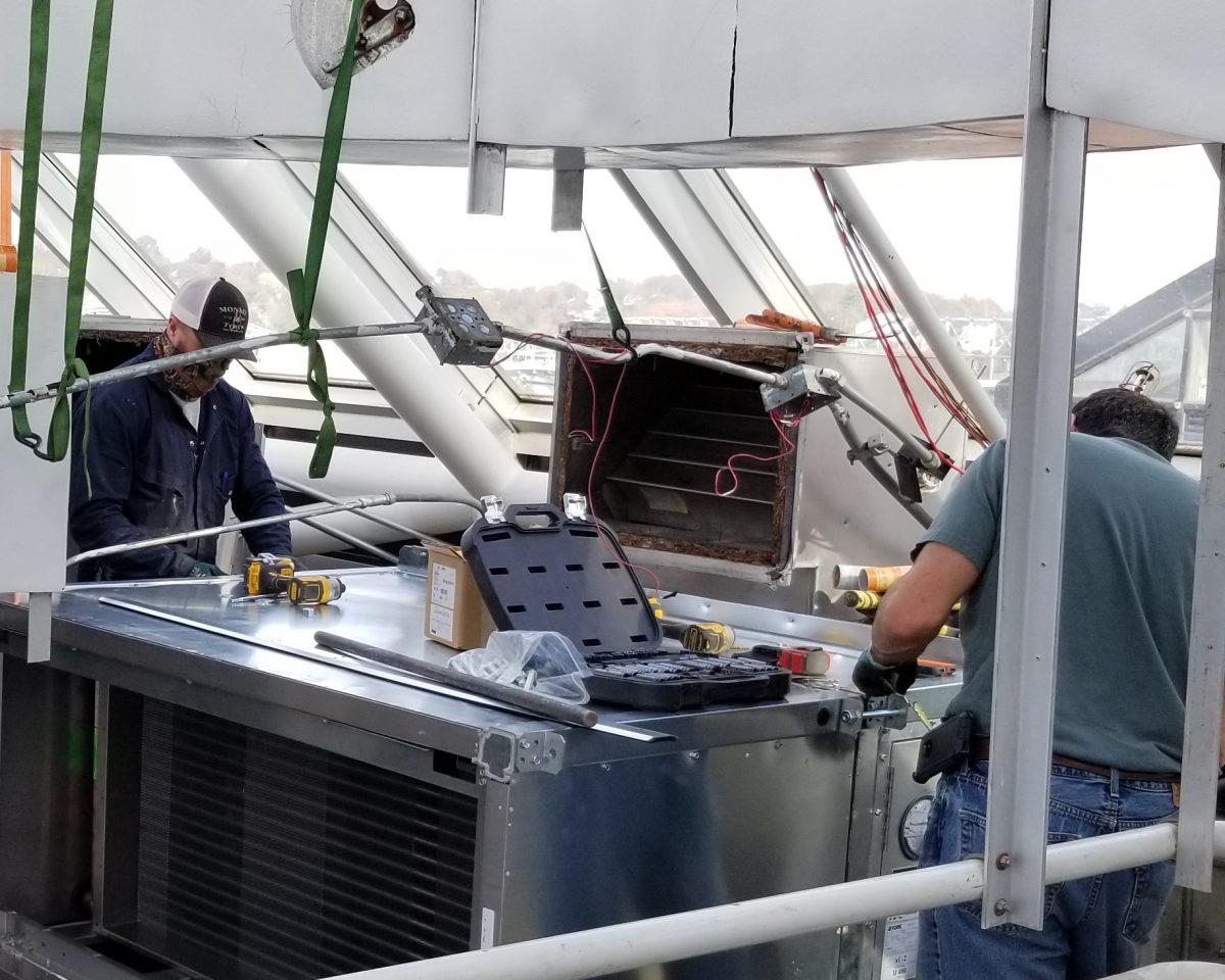 Crews install new HVAC equipment to improve air quality in the Aquarium
