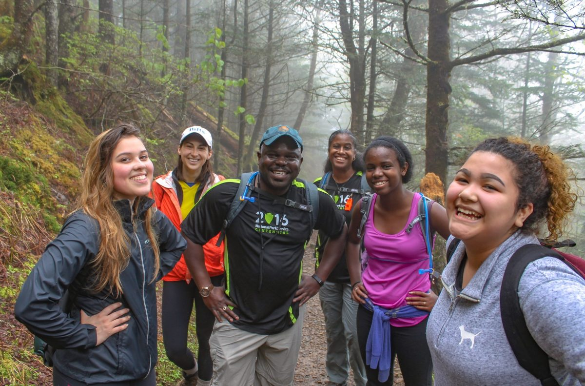 Cassius Cash with hikers in the woods