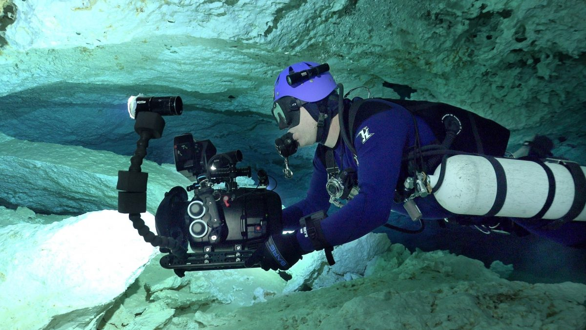 underwater cameraperson in cave