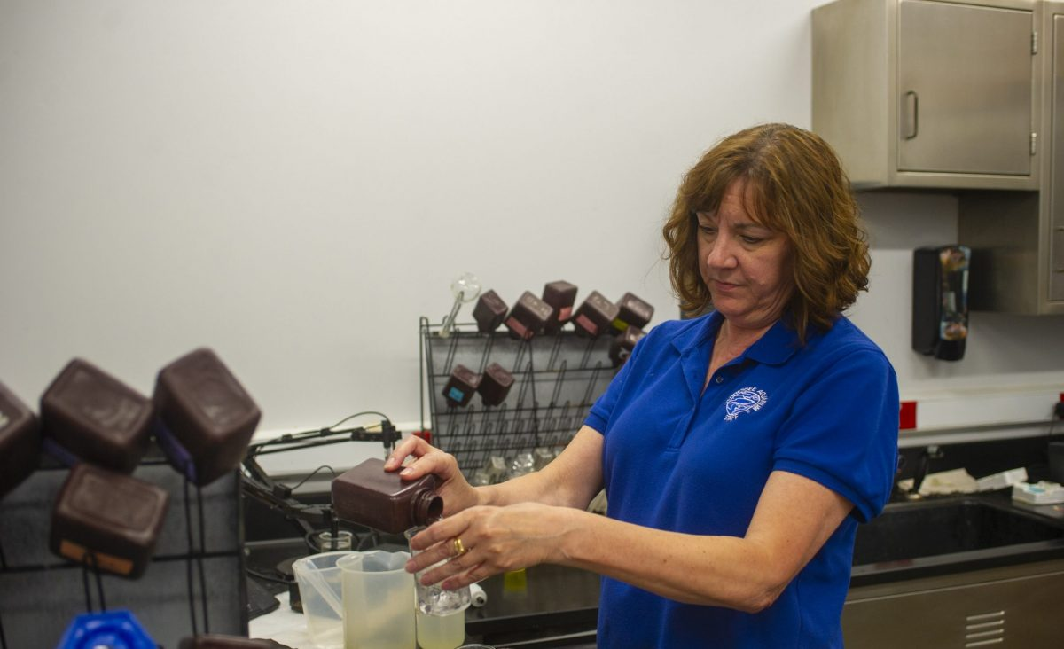 Senior Lab Technician Tina Stewart prepares water samples for testing