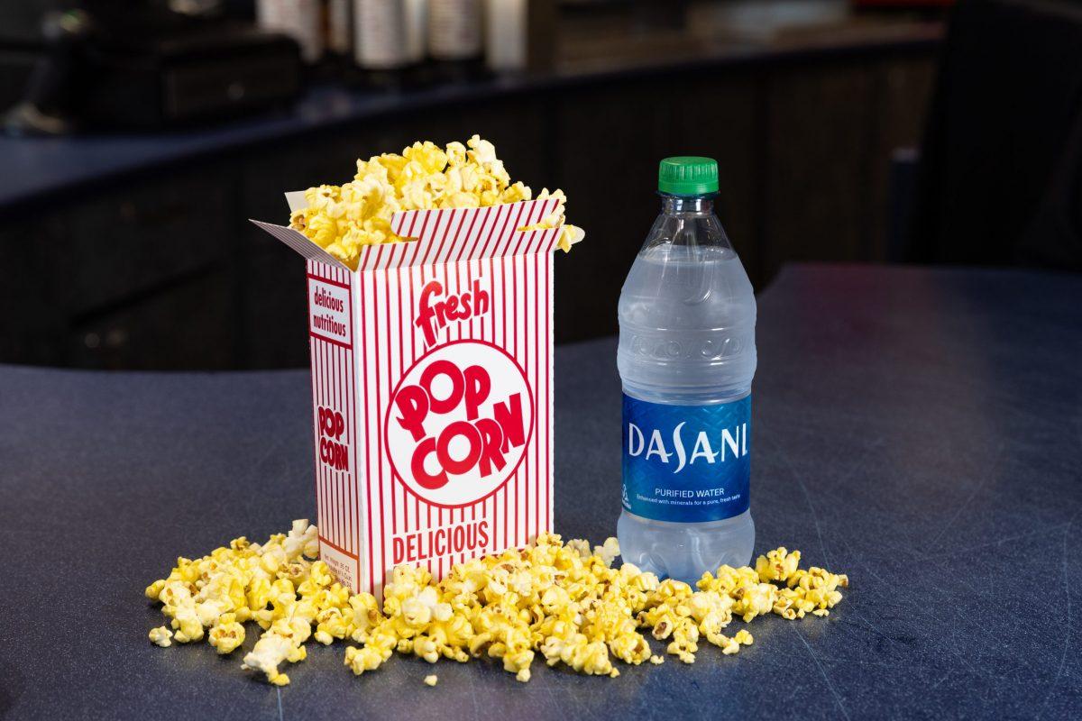 box of popcorn beside bottled water