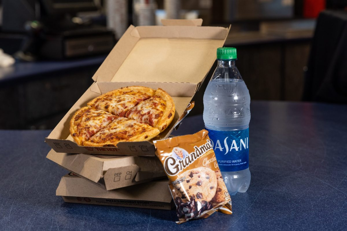 personal pan pizza with bottled water and cookie